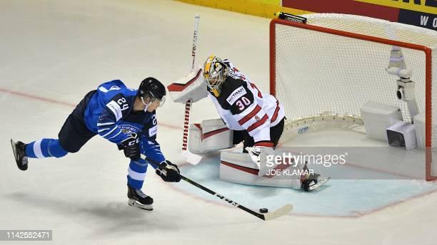 Finland's forward Kaapo Kakko scores against Canada's goalkeeper Matt Murray during the IIHF Men's Ice Hockey World Championships Group A match...