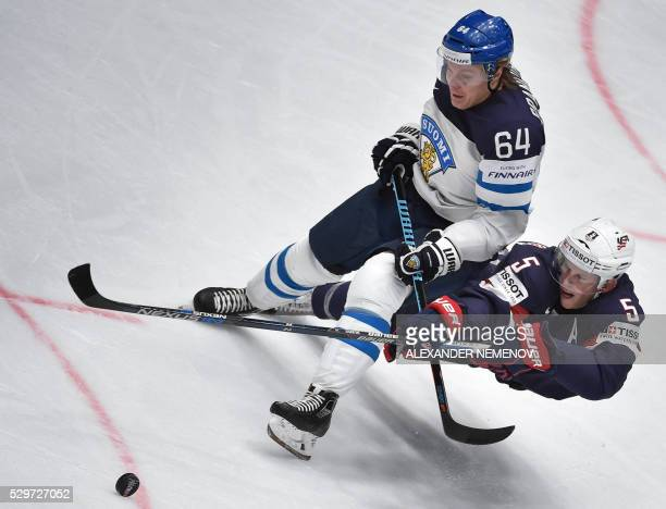 Finland's forward Mikael Granlund vies with US defender Connor Murphy during the group B preliminary round game Finland vs USA at the 2016 IIHF Ice...