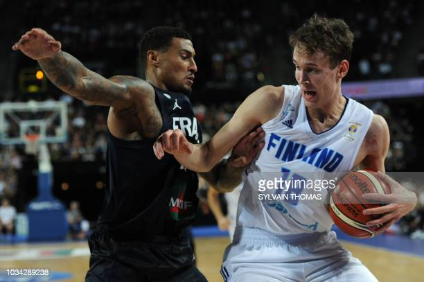 Finland's forward Mikael Jantunen vies with France's guard Edwin Jackson during the 2019 FIBA Basketball World Championship European qualifying group...