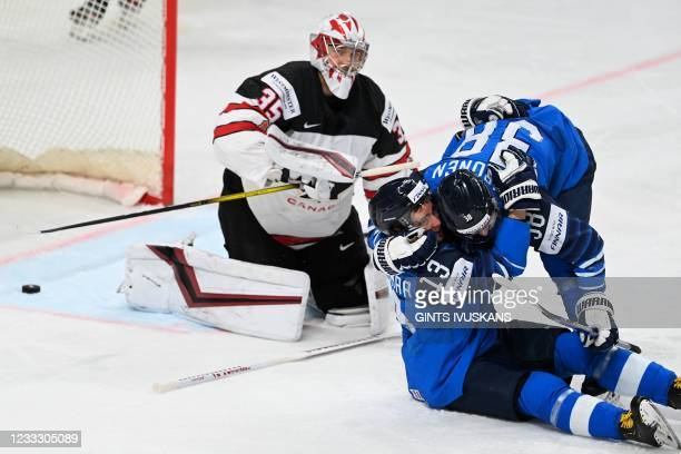 Finland's forward Mikael Ruohomaa celebrates with Finland's forward Teemu Turunen after scoring the 1-0 goal against Canada's goalkeeper Darcy...