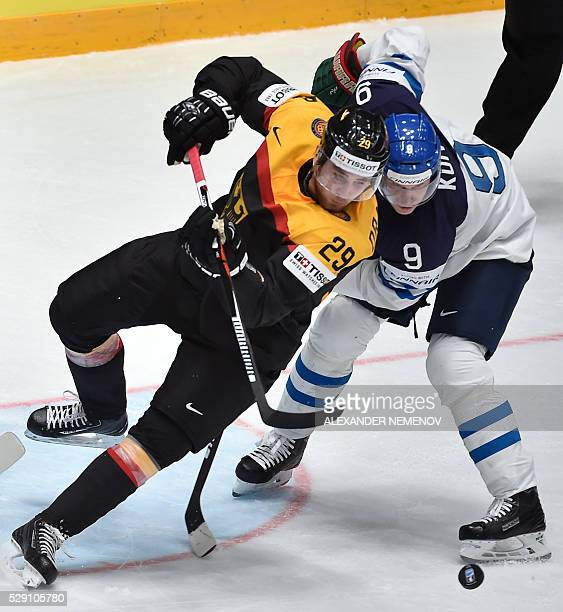 Finland's forward Mikko Koivu vies with Germany's forward Leon Draisaitl during the group B preliminary round game Finland vs Germany at the 2016...