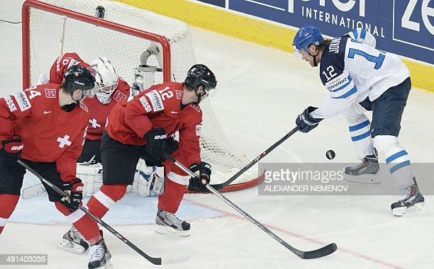Finland's forward Olli Jokinen attacks Swiss net during a preliminary round group B game Finland vs Switzerland of the IIHF International Ice Hockey...