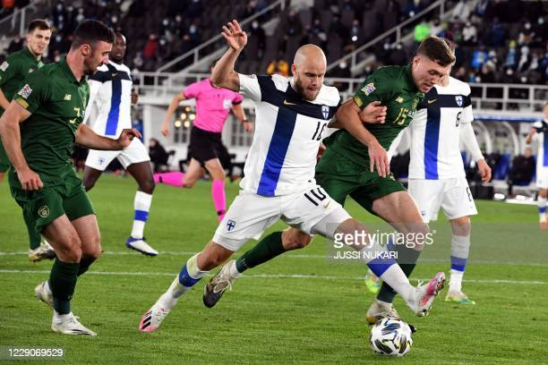 Finland's forward Teemo Pukki and Ireland's defender Dara O'Shea vie for the ball during the UEFA Nations League football match Finland v Ireland in...