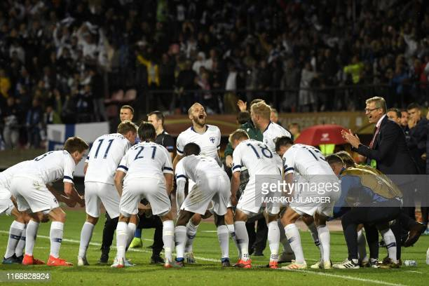 Finland's forward Teemo Pukki celebrates with his teammates after scoring the 1-1 equalizing goal during the UEFA Euro 2020 Group J qualification...