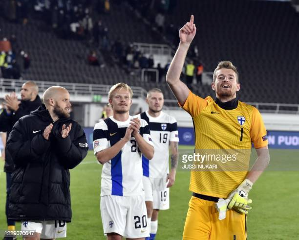 Finland's forward Teemo Pukki, Finland's forward Joel Pohjanpalo and Finland's goalkeeper Lucas Hradecky celebrate after winning the UEFA Nations...