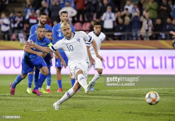 Finland's forward Teemo Pukki scores from the penalty spot during the Euro 2020 football qualification match between Finland and Greece in Tampere,...