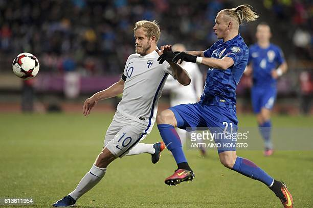 Finland's forward Teemu Pukki and Croatia's defender Domagoj Vida vie for the ball during the 2018 World Cup qualifier football match of Finland vs...