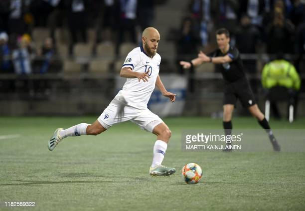 Finland's forward Teemu Pukki scores the 2-0 trough a penalty during the UEFA Euro 2020 Group J qualification football match between Finland and...