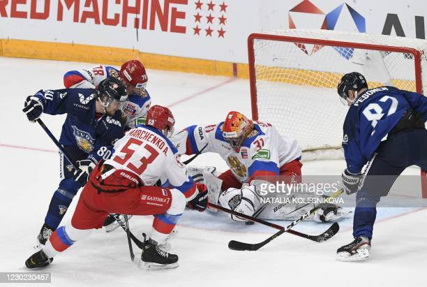 Finland's forward Teemu Turunen tries to score to Russia's goaltender Alexander Samonov during the Channel One Cup of the Euro Hockey Tour ice hockey...