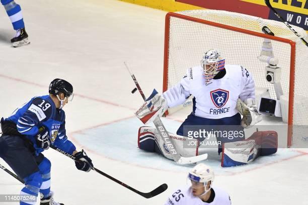 Finland's forward Veli-Matti Savinainen attempts to score past France's goalkeeper Florian Hardy during the IIHF Men's Ice Hockey World Championships...