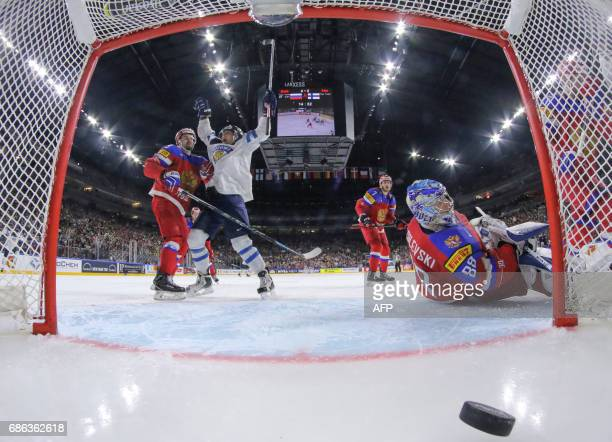 TOPSHOT Finland´s forward VeliMatti Savinainen celebrates scoring his teams third goal during the IIHF Men's World Championship Ice Hockey bronze...