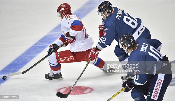 Finland's forwards Roope Hintz and Harri Pesonen try to stop Russia's forward Dmitry Kugryshev during the Channel One Cup of the Euro Hockey Tour ice...