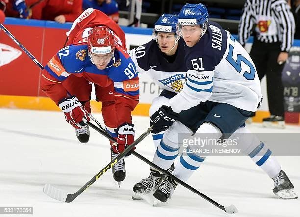 Finland's forwards Tomi Sallinen and Jarno Koskiranta vie with Russia's forward Yevgeni Kuznetsov during the semifinal game Finland vs Russia at the...