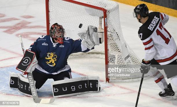 Finland's goalie Eero Kilpelainen makes a save during the Ice Hockey Euro Hockey Tour Karjala Cup match between Finland and Canada in Helsinki,...