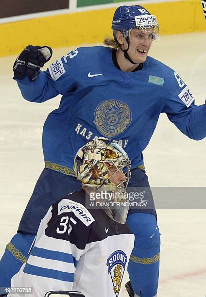 Finland's goalie Pekka Rinne lets the puck into his net as Kazakhstan's forward Vadim Krasnoslobodtsev celebrates during a preliminary round group B...