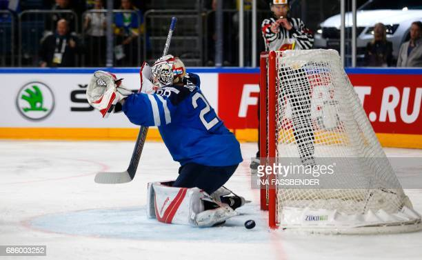 Finland's goalkeeper Harri Sateri fails to save the 2-1 goal during the IIHF Men's World Championship Ice Hockey semi-final match between Sweden and...