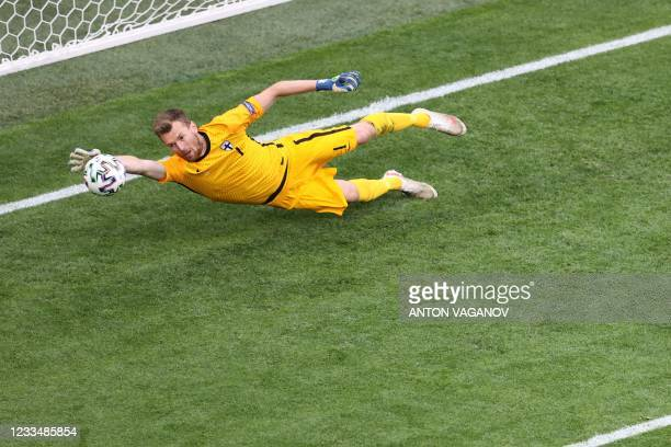 Finland's goalkeeper Lucas Hradecky makes a save during the UEFA EURO 2020 Group B football match between Finland and Russia at the Saint Petersburg...
