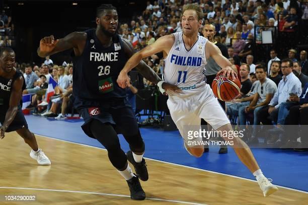 Finland's guard Petteri Koponen vies with France's forward Mathias Lessort during the 2019 FIBA Basketball World Championship European qualifying...