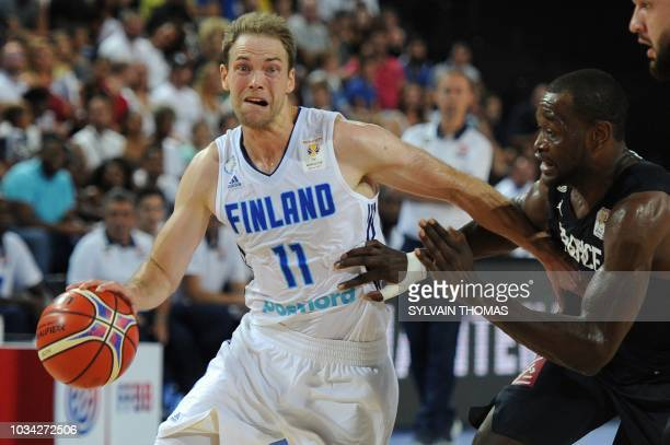 Finland's guard Petteri Koponen vies with France's guard Charles Kahudi during the 2019 FIBA Basketball World Championship European qualifying group...