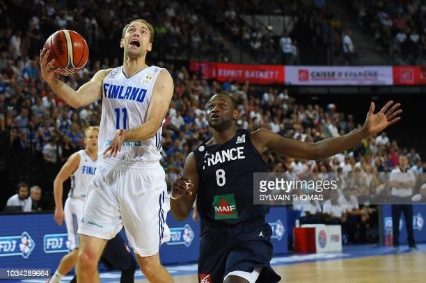 Finland's guard Petteri Koponen vies with France's guard Charles Kahudi during the 2019 FIBA Basketball World Championship European qualifying group...