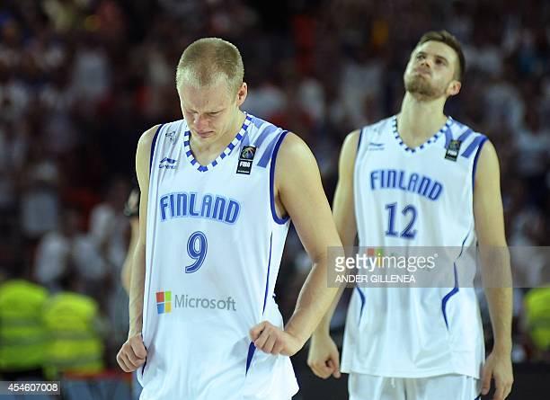 Finland's guard Sasu Salin and forward Matti Nuutinen react after the 2014 FIBA World basketball championships group C match Finland vs New Zealand...