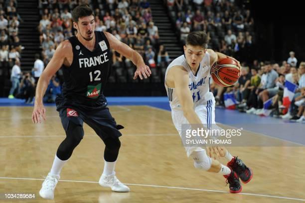 Finland's guard Topias Palmi vies with France's guard Nando De Colo during the 2019 FIBA Basketball World Championship European qualifying group...