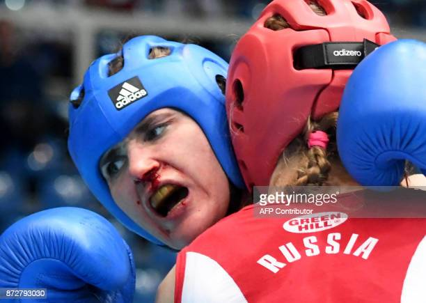 Finland's Hanna Raatesalmi fights with Russia's Anna Poskrebysheva in the 'Women K1 52kg category' in the 'BOK' sports hall in Budapest on November 9...