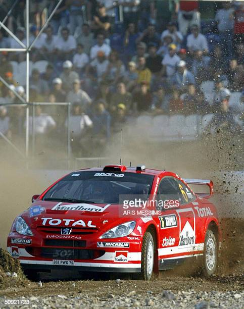Finland's Harri Rovampera and his codriver Risto Pietilainen with their Peugeot 307 steers during the Acropolis rally of Greece in Lilea special...