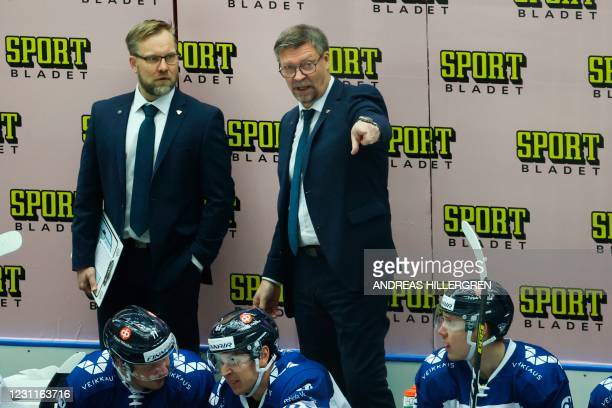 Finland's head coach Jukka Jalonen and assitant Ari-Pekka Selin react during Euro Hockey Tour between Sweden and Finland on February 14, 2021 at...