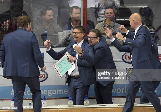 Finland's head coach Jukka Jalonen and his crew celebrate after the 2016 IIHF World Junior Ice Hockey Championship semifinal match between Sweden and...