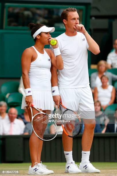 Finland's Henri Kontinen and Britain's Heather Watson react against India's Rohan Bopanna and Canada's Gabriela Dabrowski during their mixed doubles...