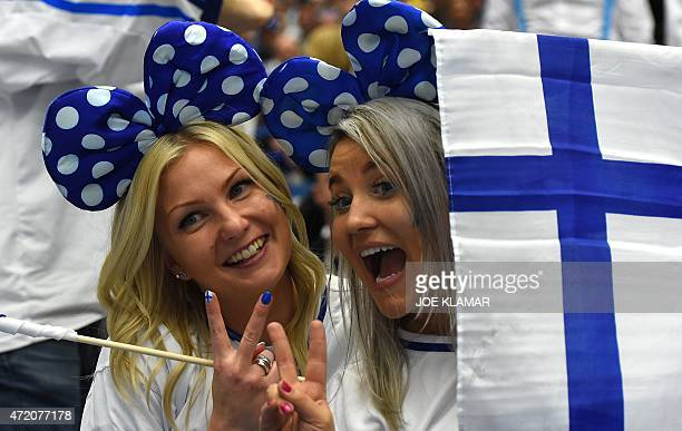 Finland's hockey fans celebrate during the group B preliminary round ice hockey match Denmark vs Finland of the IIHF International Ice Hockey World...
