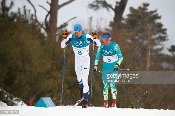 Finland's Iivo Niskanen and Kazakhstan's Alexey Poltoranin compete during the men's 50km cross country mass start classic at the Alpensia cross...