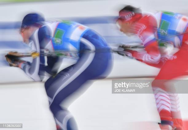Finland's Iivo Niskanen and Russia's Alexander Bessmertnykh compete during the Men's cross country skiing relay 4x10km event at the FIS Nordic World...
