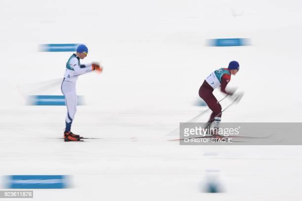 TOPSHOT Finland's Iivo Niskanen and Russia's Alexander Bolshunov compete during the men's 50km cross country mass start classic at the Alpensia cross...