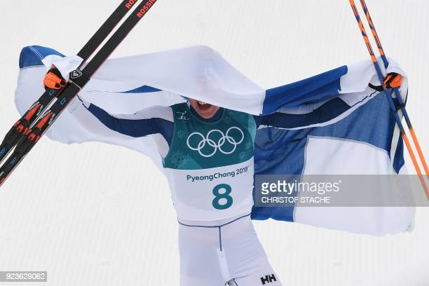 TOPSHOT Finland's Iivo Niskanen celebrates after crossing the finish line to win gold in the men's 50km cross country mass start classic at the...