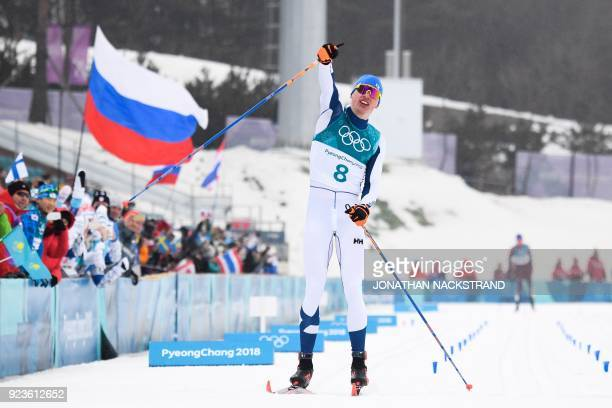 Finland's Iivo Niskanen crosses the finish line to win gold in the men's 50km cross country mass start classic at the Alpensia cross country ski...
