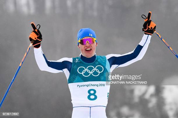 TOPSHOT Finland's Iivo Niskanen crosses the finish line to win gold in the men's 50km cross country mass start classic at the Alpensia cross country...
