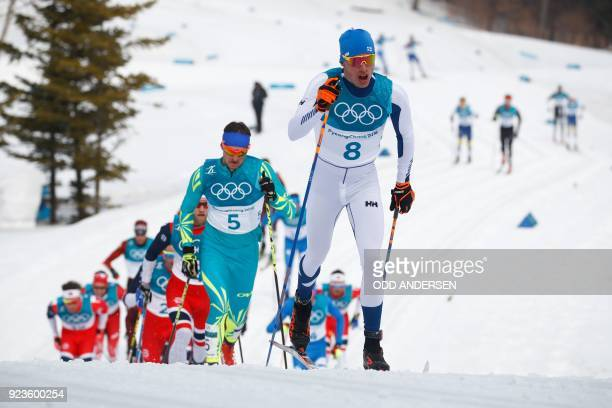 TOPSHOT Finland's Iivo Niskanen followed by Kazakhstan's Alexey Poltoranin compete during the men's 50km cross country mass start classic at the...