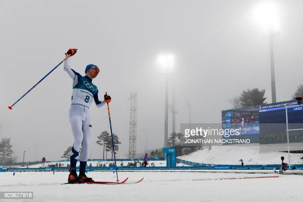 TOPSHOT Finland's Iivo Niskanen reacts after crossing the finish line to win gold in the men's 50km cross country mass start classic at the Alpensia...