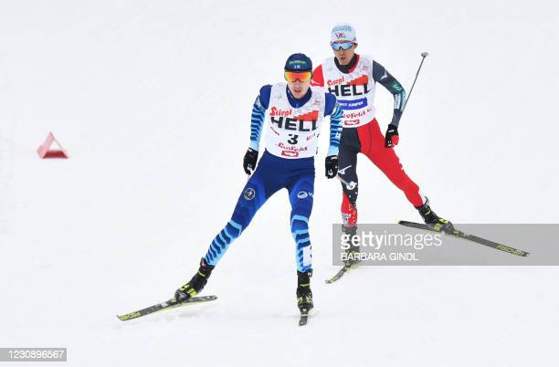 Finland's Ilkka Herola and Japan's Akito Watabe compete during the 15km competition of the FIS Nordic Combined World Cup in Seefeld, Austria, on...