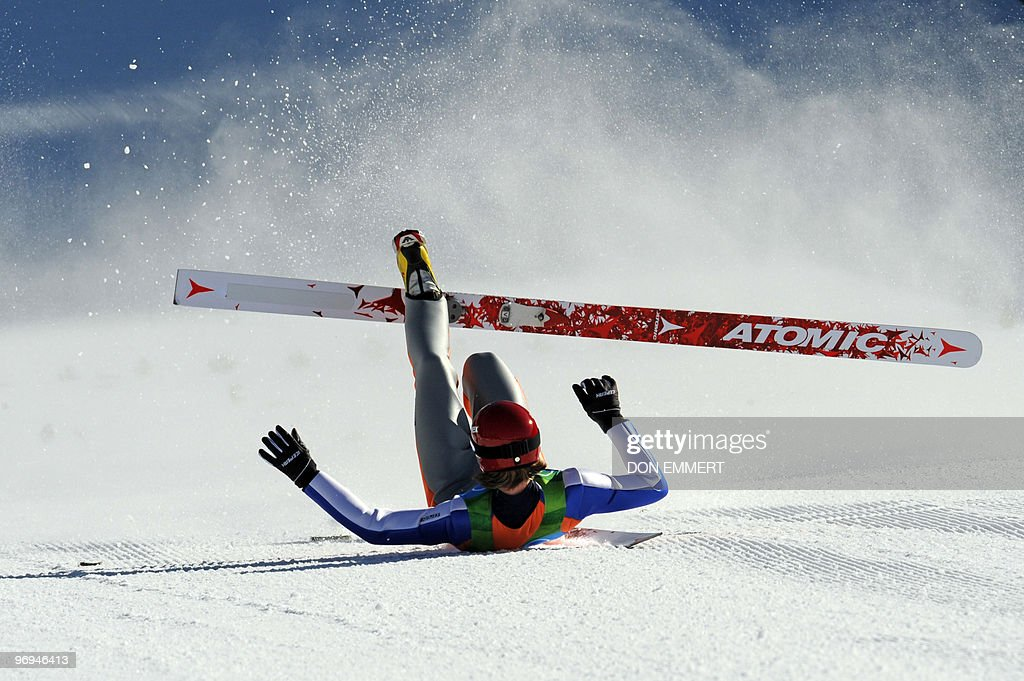 Finland's Janne Ahonen falls after landing in the Ski Jumping LH Individual trial at Whistler Olympic Park on February 20, 2010 during the Vancouver Winter Olympics.