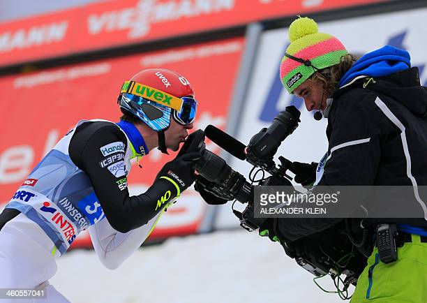 Finland's Janne Ahonen kisses a camera during the Four Hills competition of the FIS Ski Jumping World Cup in Innsbruck on January 4, 2014. AFP PHOTO...