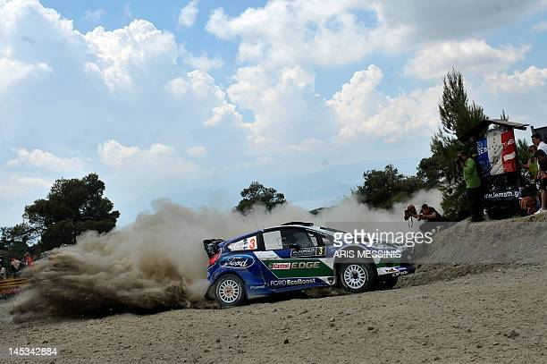 Finland's JariMatti Latvala and his codriver Mikka Anttila drive their Ford Fiesta RS WRC during the Agioi Theodoroi special stage of the WRC...