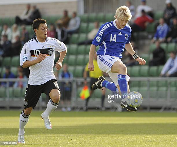 Finland's Joni Aho takes possession of the ball in front of Germany's Mesut Ozil during their group B Euro U21 soccer match at Orljans Vall Arena in...