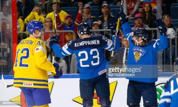 Finland's Joonas Kemppainen and Lasse Kukkonen celebrate a goal during the IIHF Men's World Championship Ice Hockey semi-final match between Sweden...