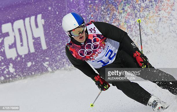 Finland's Jouni Pellinen competes in the Men's Freestyle Skiing Ski Cross seeding runs at the Rosa Khutor Extreme Park during the Sochi Winter...