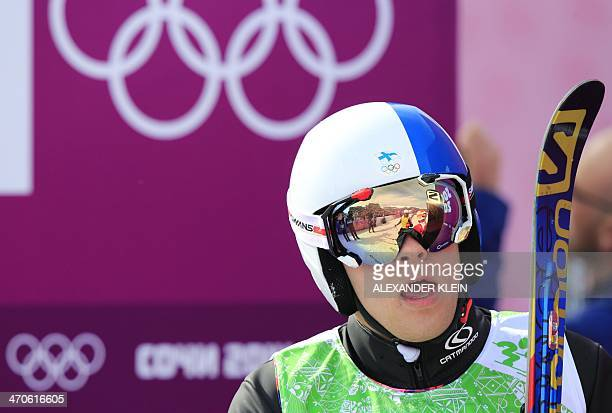 Finland's Jouni Pellinen looks at his score after competing in the Men's Freestyle Skiing Ski Cross 1/8 Finals at the Rosa Khutor Extreme Park during...
