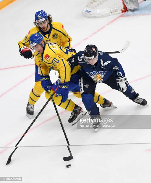 Finland's Julius Junttila vies Sweden's defenceman Viktor Loov during the Channel One Cup of the Euro Hockey Tour ice hockey match between Finland...
