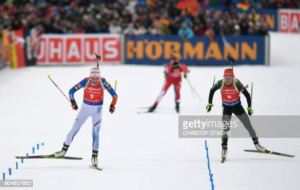 Finland's Kaisa Makarainen and Germany's Laura Dahlmeier compete in the finish during the women 125 kilometer mass start competition of the Biathlon...